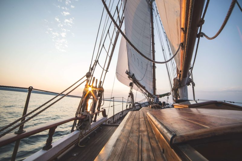 View of a sailboat sailing during sunset