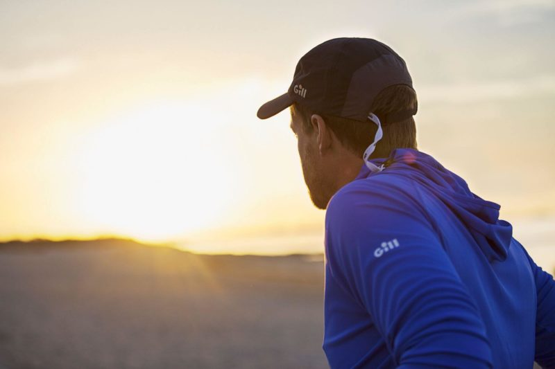 Man wearing UV Cap during Sunset