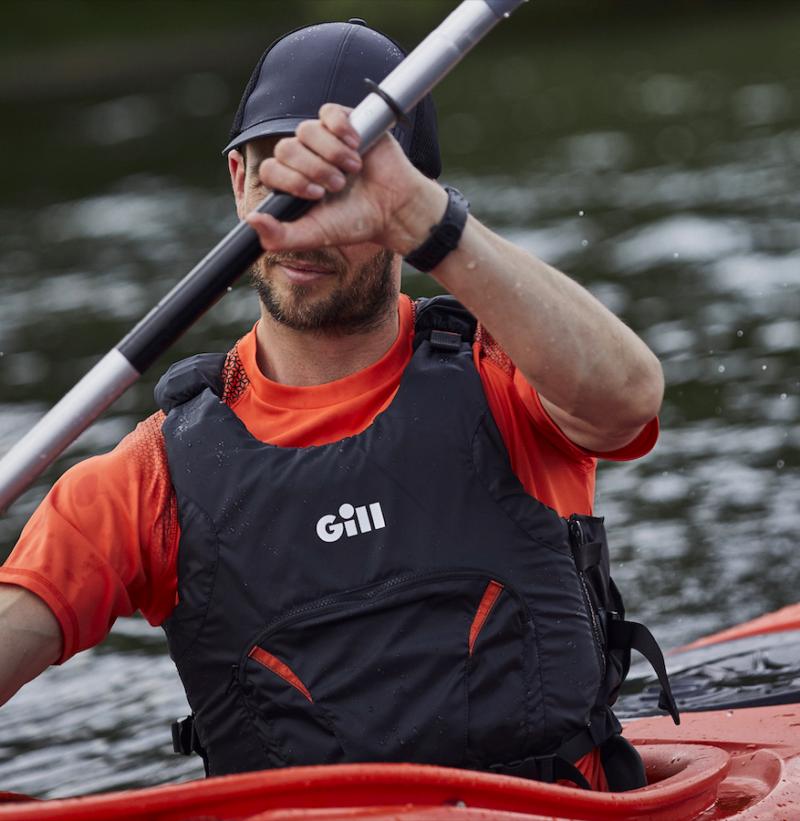 Man kayaking wearing the Pro Racer Bouyancy Aid