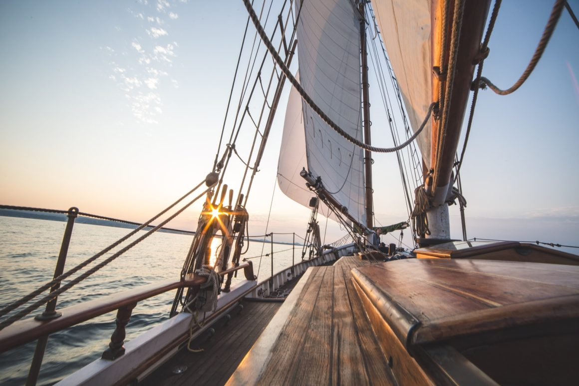 Sailing into the sunset on board a sailboat with ropes and knots