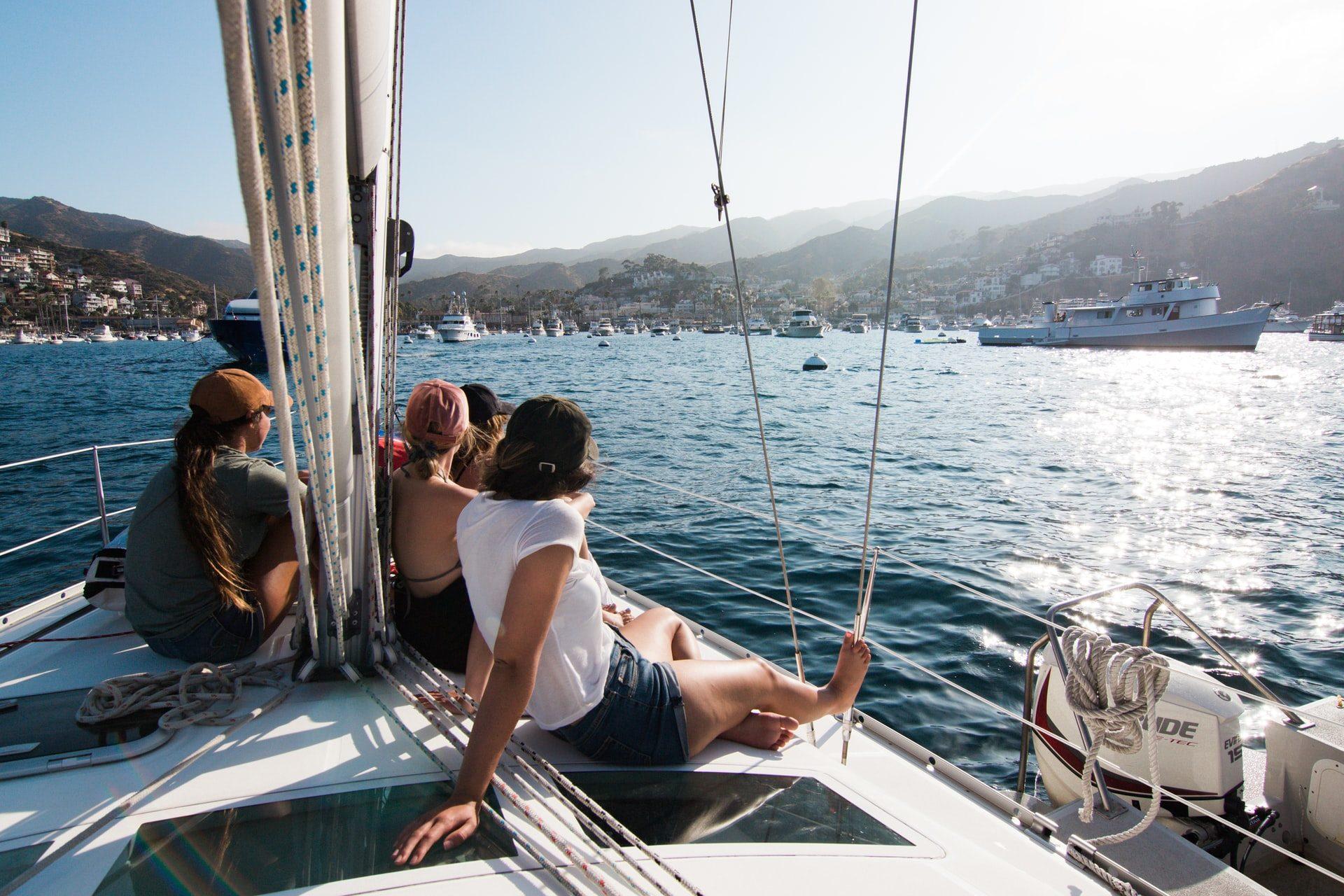 People on a sailboat arriving at Santa Catalina Island