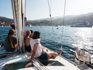 People on a sailboat arriving at Santa Catalina Island