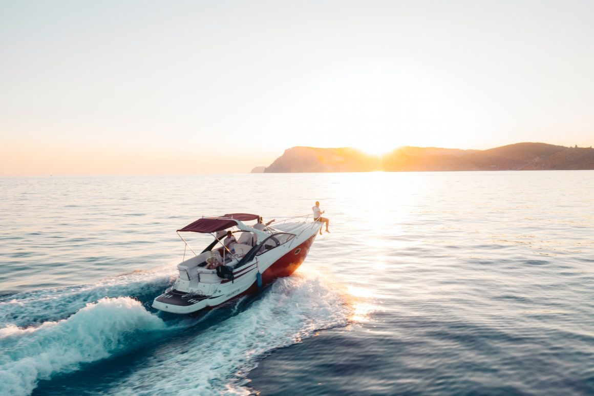 Cruising during sunset on a motorboat