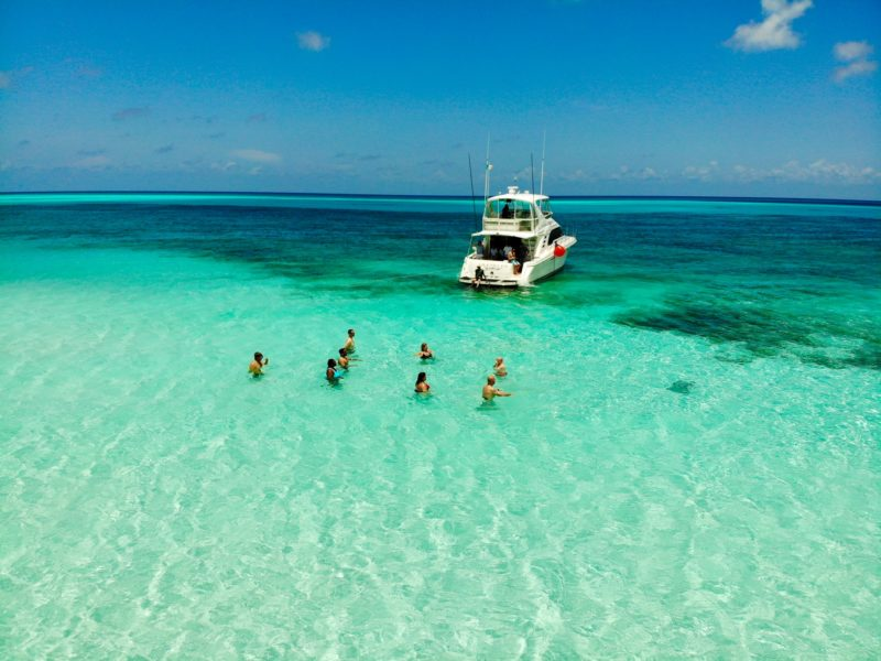 People enjoying swimming in El Cozumel