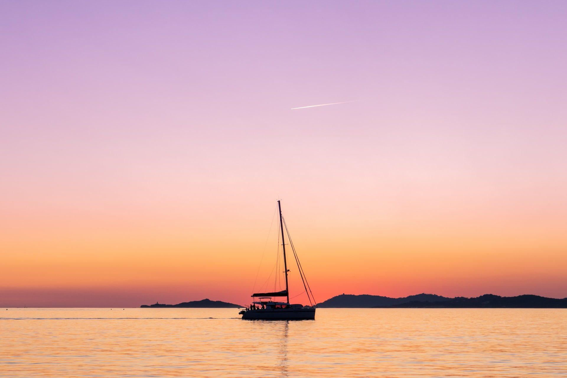Catamaran cruising during sunset