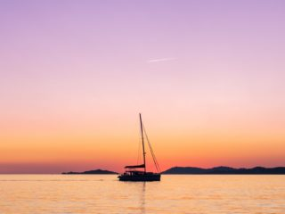Catamaran cruising during sunset