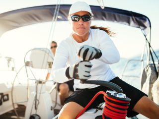 Female sailor on board a sailboat