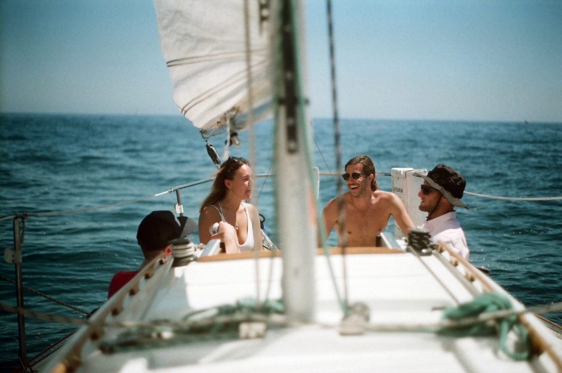 Group of friends on a sailboat